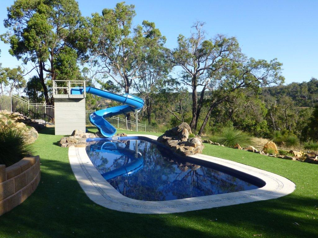 Types of swimming pool slides to add to your pool Swimming pools in surrey with slides