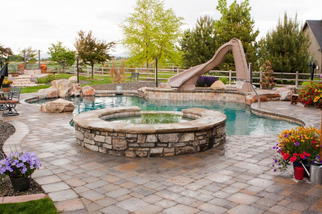 Why Rock Waterslides Should Be A Water Feature In Your Swimming Pool