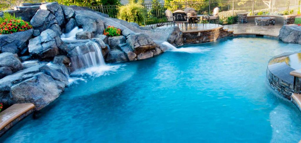 Incorporating A Waterfall With Your Backyard Pool Premier Pools Spas Pool Builders And Contractors