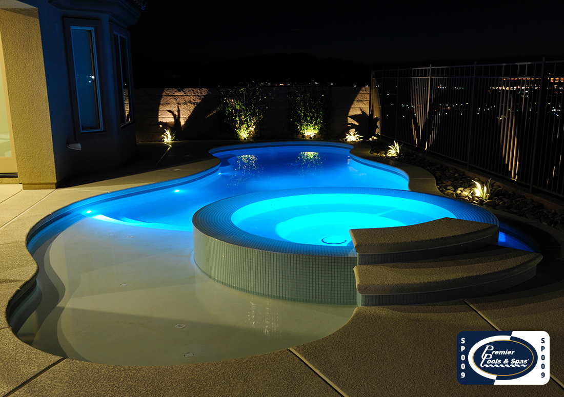 pool and spa with lights